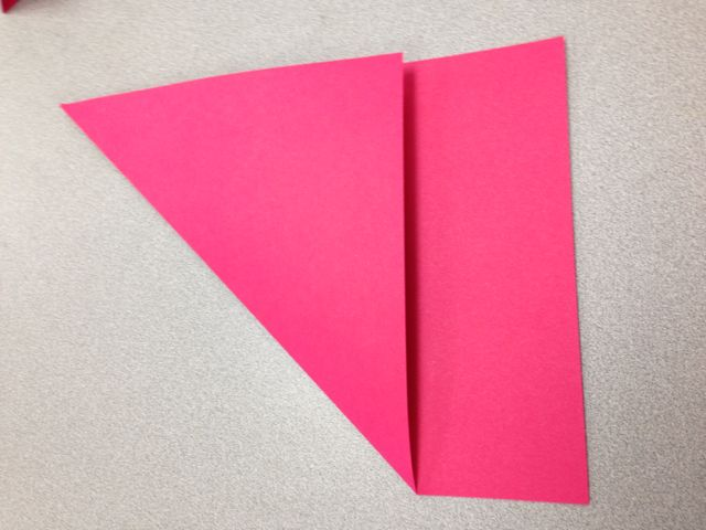 Fold one corner over to make a giant triangle.