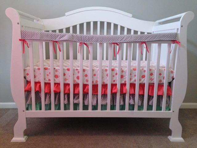 Here is my hot air balloon crib sheet complete with our ruffle crib skirt and teething rail!