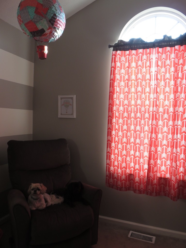 Love the coral arrow curtains we made.