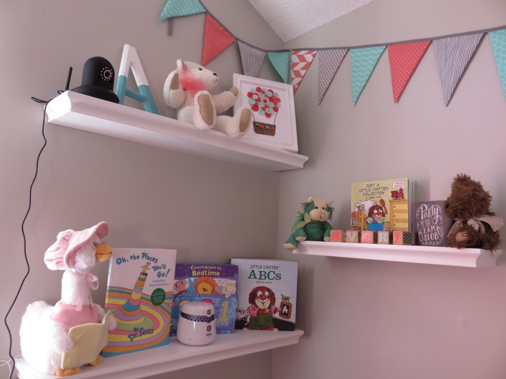 Love the shelves.  We put the baby monitor camera at the top overlooking the crib.  I also have my brother Karlton's 4H cow overlooking her crib.  It means a lot to me to have this in her nursery.