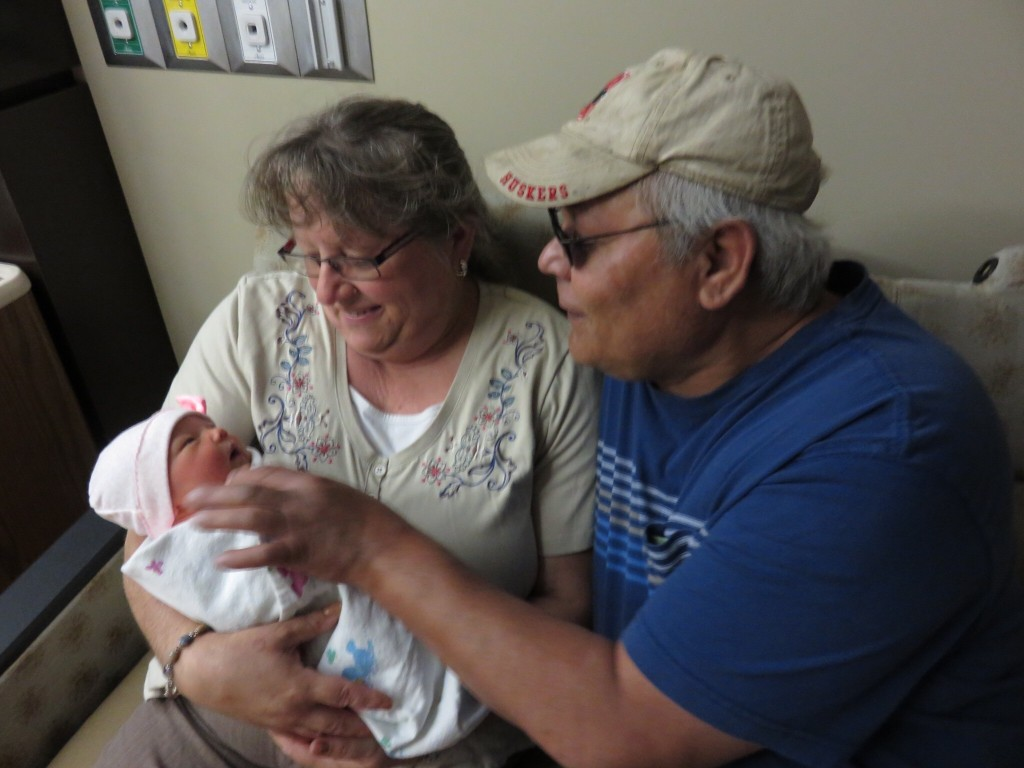 Grandma and Grandpa Tafoya get their hands on our sweet girl!