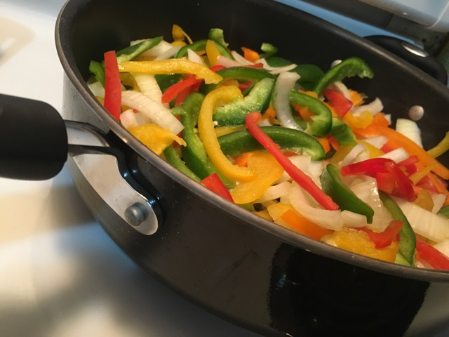 I sauté' the veggies first with a little olive oil and garlic powder. I usually use minced garlic, but we were out. The tenderized round steak cooks pretty cook, so don't throw that in before the veggies are soft or it will be way too tough.