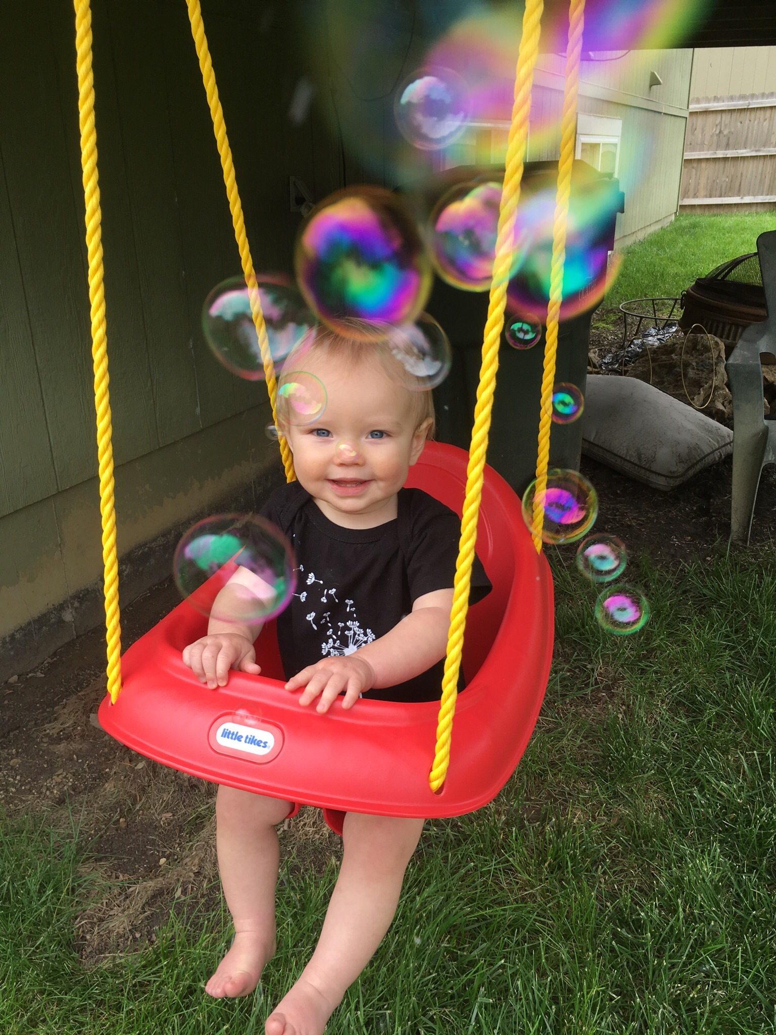 Two things Avery loves....bubbles and swinging!